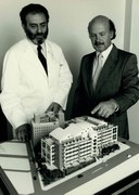 Les Lazarus (left) and John Shine (right) with the initial model of Garvan in 1988